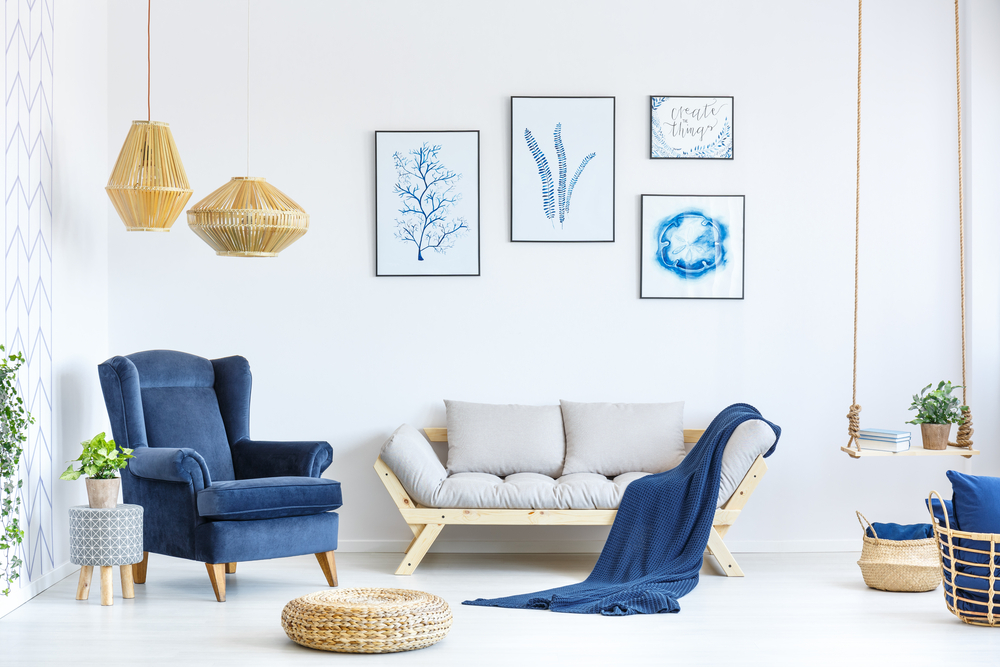 White,And,Blue,Living,Room,With,Sofa,,Armchair,,Lamp,,Posters